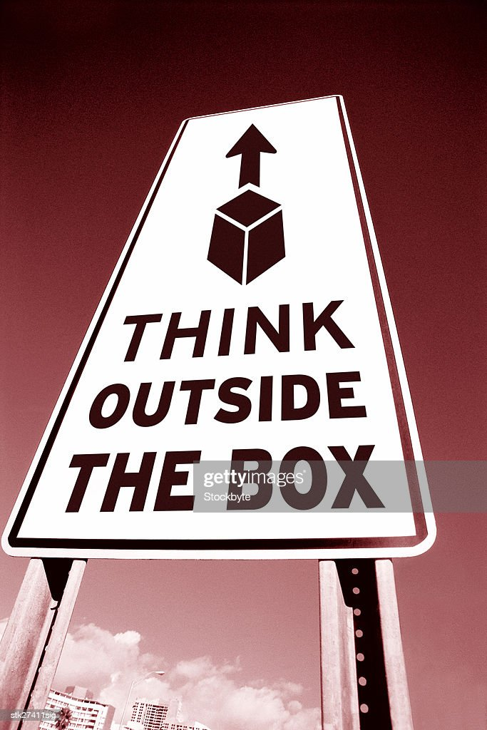 low angle toned view of a road sign saying think outside the box : Stock Photo