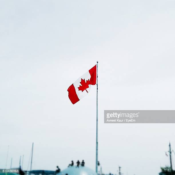Low angle view Canadian flag against clear sky