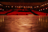 An artistic view from a theater stage out to the audience.