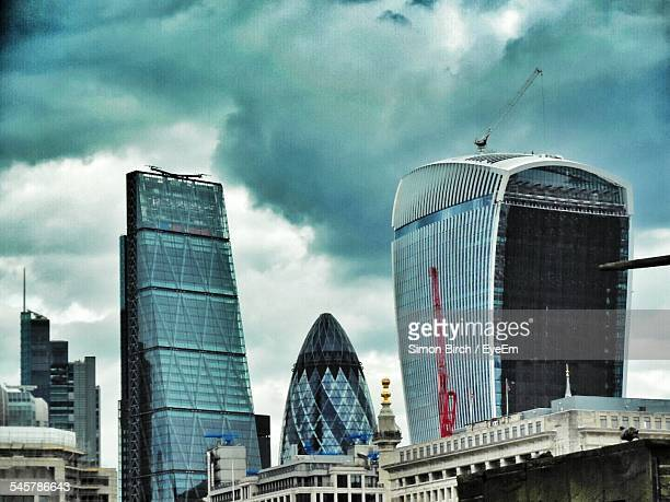 Low Angle View Of 30 St Mary Axe And Leadenhall Building With 20 Fenchurch Street Against Cloudy Sky