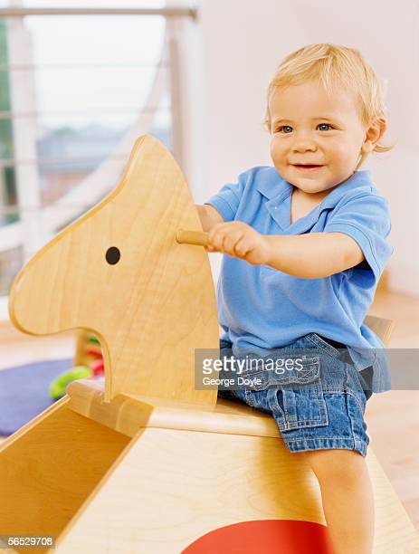low angle view of a baby boy sitting on a rocking chair