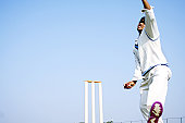 Low angle view of a bowler in action