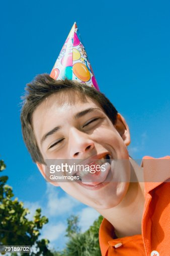 Low angle view of a boy eating a candy : Stock Photo