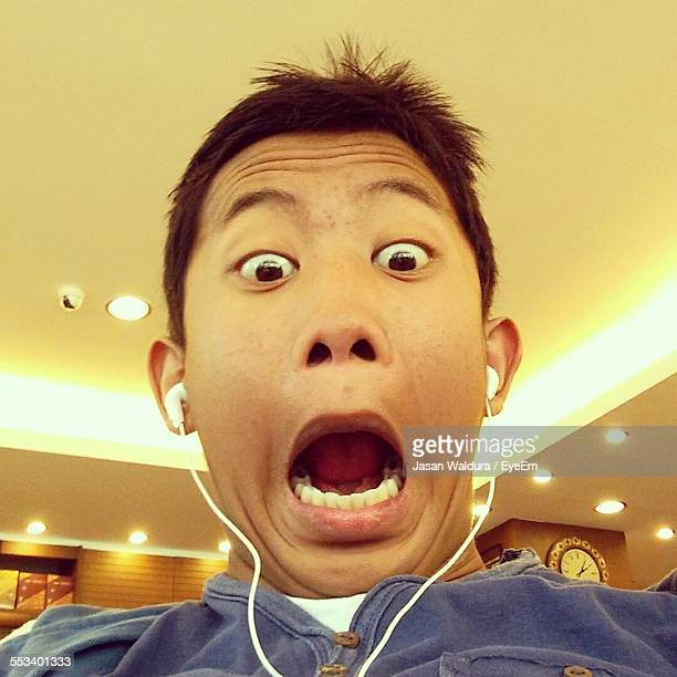 Low Angle View Of A Boy Making Face