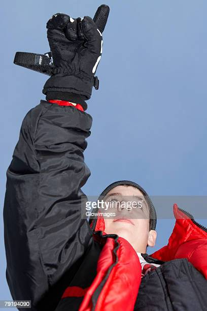 Low angle view of a boy pointing