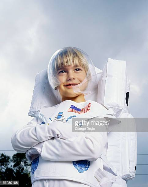 Low angle view of a boy pretending to be an astronaut
