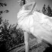 Low angle view of a bride running in a garden