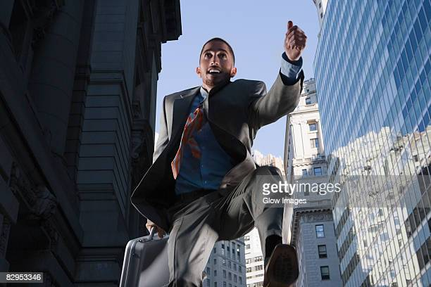 Low angle view of a businessman in mid-air