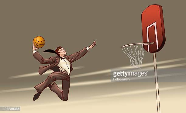 Low angle view of a businessman reaching towards a basketball hoop