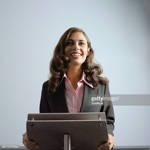 low angle view of a businesswoman standing at a podium