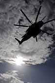 A CH-53E Super Stallion helicopter from Marine Heavy Helicopter Squadron 461 (HMH-461) flies overhead in route to dropping off Dominican airmen who minutes later poured out of the helicopter to practi