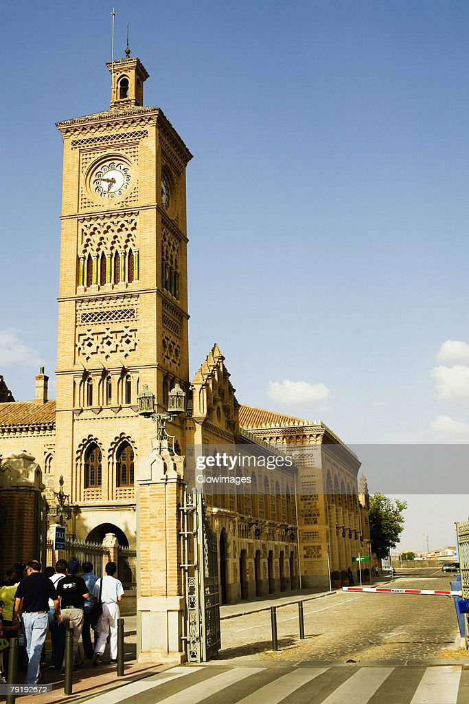 Low angle view of a clock tower at the roadside, Toledo, Spain : Stock Photo