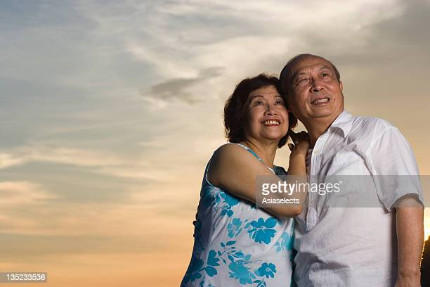 Low angle view of a couple standing together and smiling