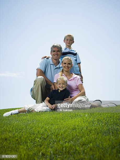 Low angle view of a family sitting on grass