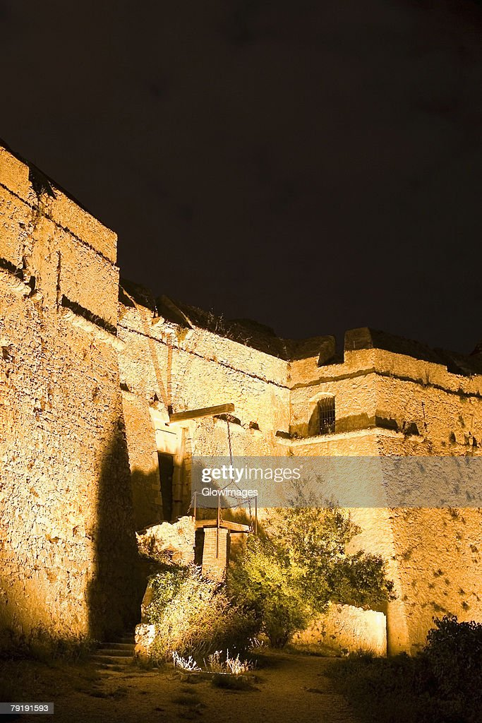 Low angle view of a fort lit up at night, Fort Du Mont Alban, Nice, France : Foto de stock