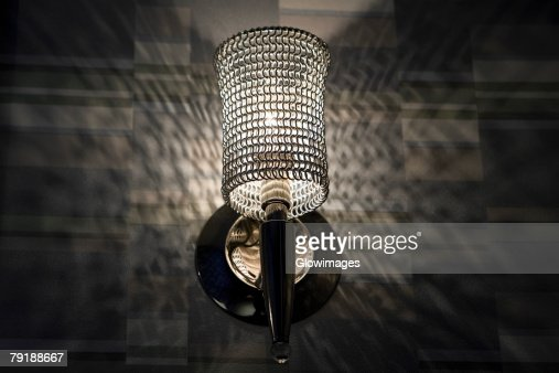 Low angle view of a lamp lit up at night : Stock Photo