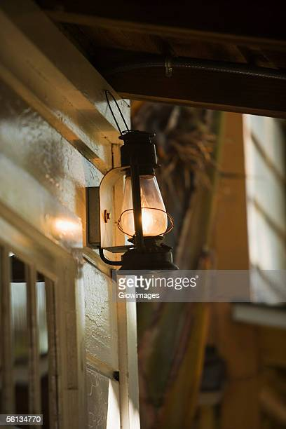 Low angle view of a lantern on a porch