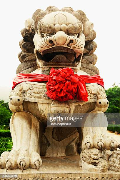 Low angle view of a lion statue at a temple, Zhanshan Temple, Qingdao, Shandong Province, China