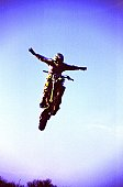 Low angle view of a man jumping in the air on a motorbike