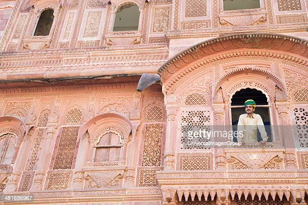 Low angle view of a man leaning on a window Meherangarh Fort Jodhpur Rajasthan India