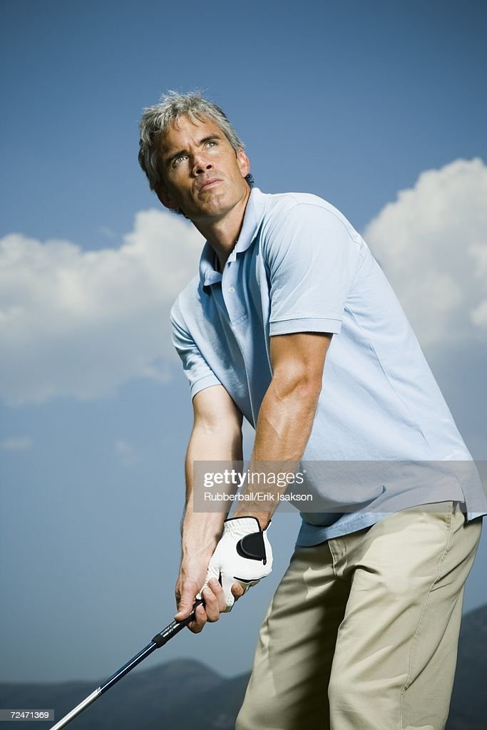 Low angle view of a man playing golf : Stock Photo