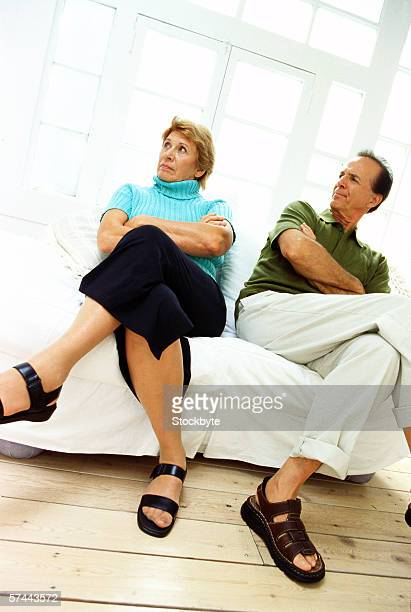 low angle view of a mature couple upset with each other