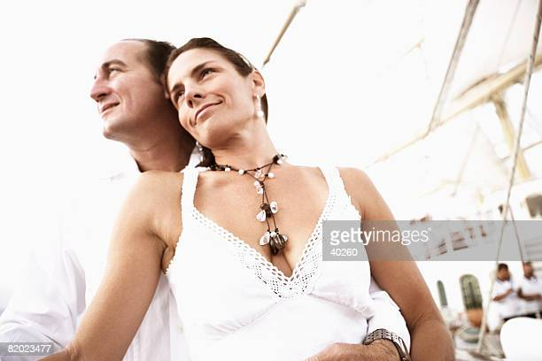 Low angle view of a mid adult couple smiling