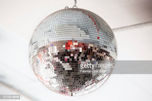 Low angle view of a mirrored disco ball in a nightclub