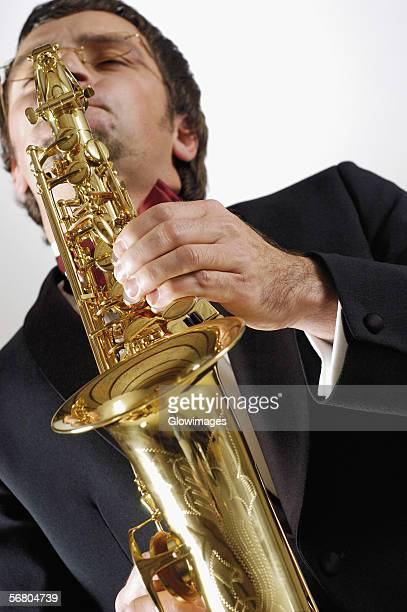 Low angle view of a musician playing the saxophone
