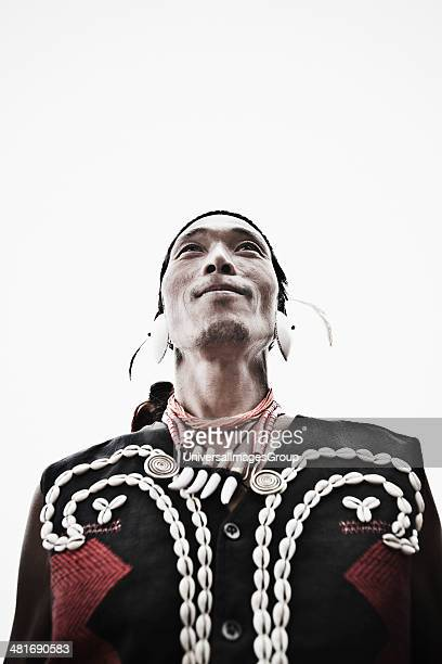 Low angle view of a Naga tribal man in traditional outfit Hornbill Festival Kohima Nagaland India