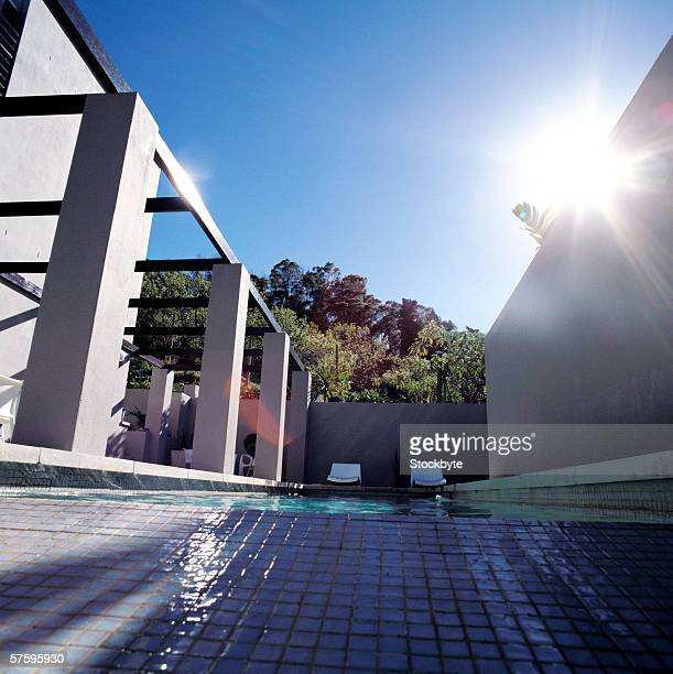 Low angle view of a patio beside a swimming pool in a house