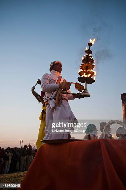 Low angle view of a priest performing evening aarti at Maha Kumbh Allahabad Uttar Pradesh India