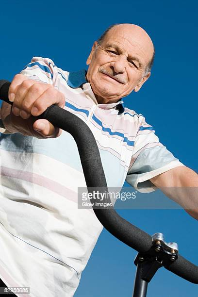 Low angle view of a senior man on a bicycle