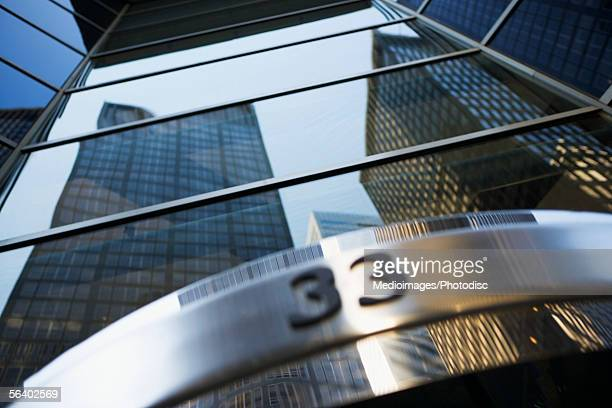 Low angle view of a skyscraper with the number 33 on it in New York City, NY, USA