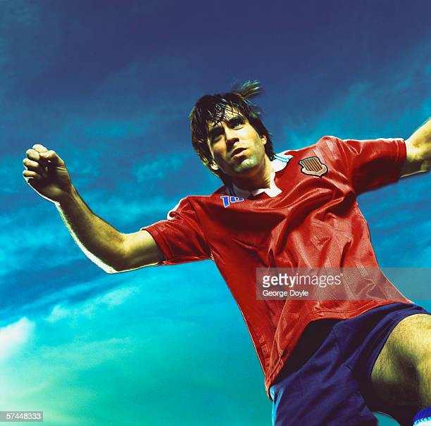 low angle view of a soccer player playing