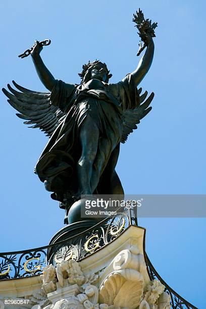 Low angle view of a statue, La Fontaine Des Quinconces, Bordeaux, Aquitaine, France