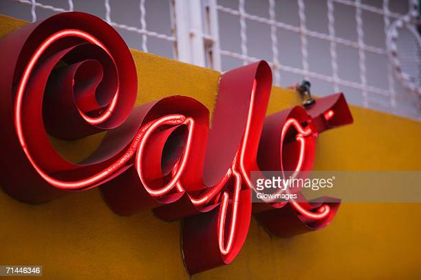 Low angle view of a store sign on a building wall