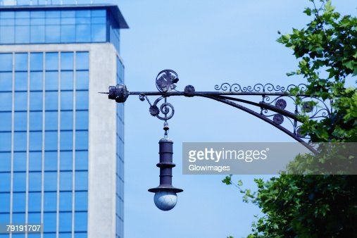Low angle view of a street light in front of a building, Barcelona, Spain : Stock Photo