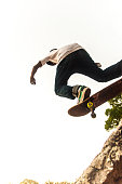 Low angle view of a teenage  boy skateboarding