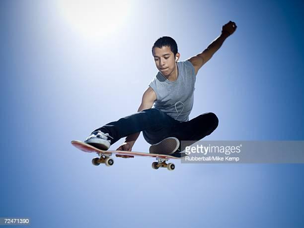 Low angle view of a teenage boy skateboarding