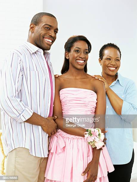 low angle view of a teenage girl standing with her parents