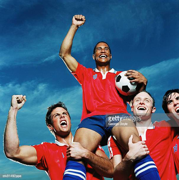 low angle view of a victorious soccer team