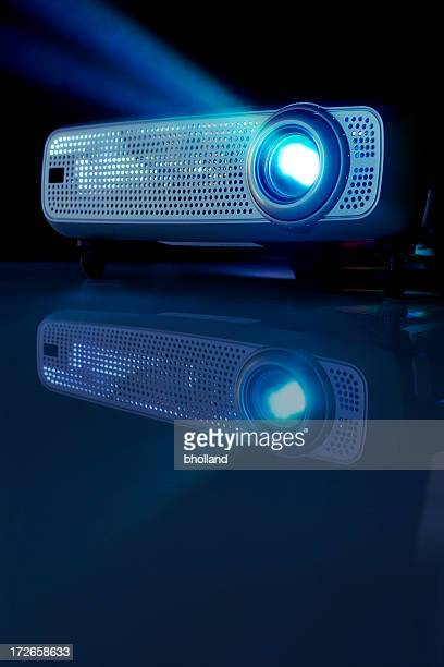Low angle view of a working LCD projector in a dark room