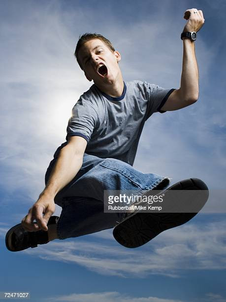 Low angle view of a young man jumping