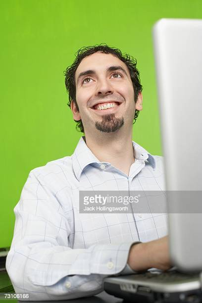 Low angle view of a young man using a laptop