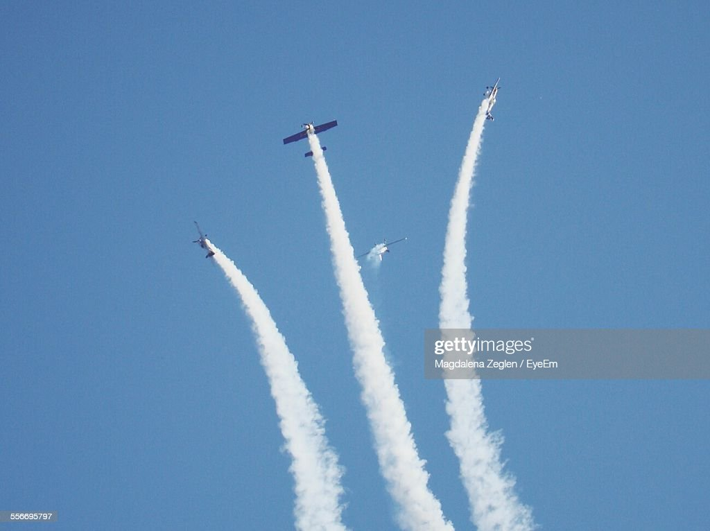 Low Angle View Of Aerobatics Team In Flight
