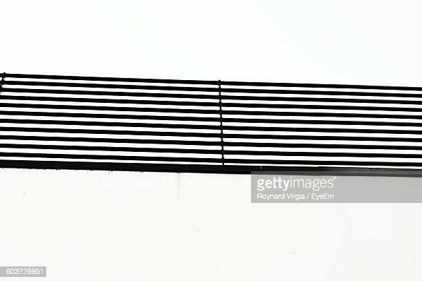 Low Angle View Of Air Duct On Wall