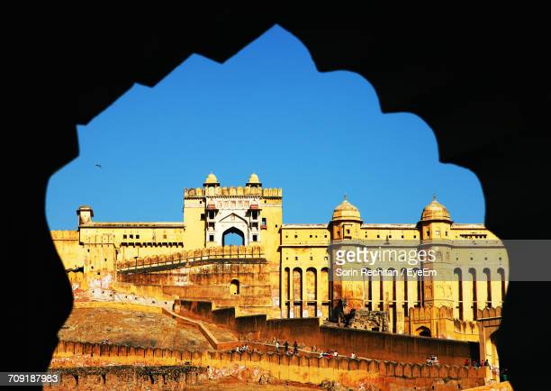 Low Angle View Of Amber Fort Seen From Archway Against Clear Blue Sky