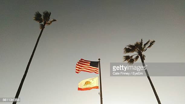 Low Angle View Of American And California Flags