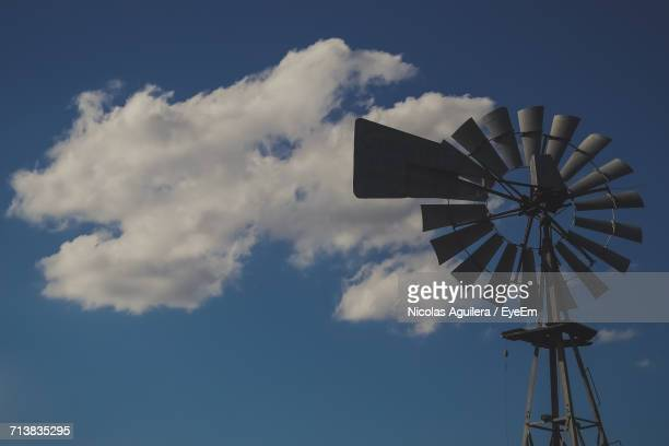 Low Angle View Of American-Style Windmill Against Blue Sky